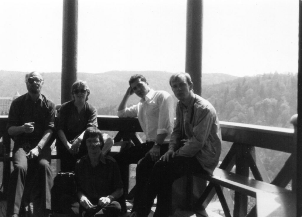 Anthony Gilbert & students on tour, 1982: a photo taken at the top of a tower in Brno, Czechoslovakia (as it was then) during a British Council tour of eastern Europe. The ensemble on the photo include Martin Butler, composer & pianist, and Joan Rodgers, soprano.